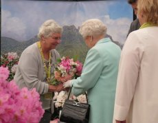 Presenting HM The Queen with a bouquet of rhododendrons
